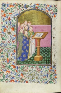 Monks singing from a lectern. Site Chant group Psallentes, dir. Hendrik Vanden Abeele